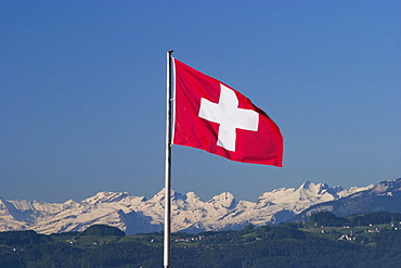 Swiss flag and Alps