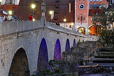 Old Stone Bridge and Brücktor city gate in Regensburg Bavaria Germany