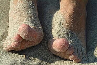 Children feets at the beach