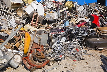 Pile of discarded household and industrial items at a scrap metal recycling centre, Quebec, Canada
