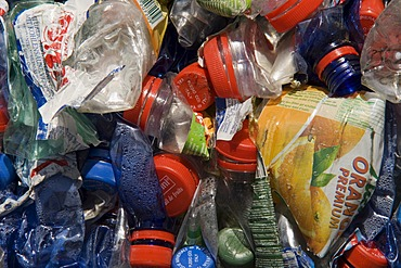 Plastic bottles, compressed into a large bale and ready for recycling