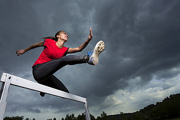 Athlete, 20 years, jumping hurdles, Winterbach, Baden-Württemberg, Germany