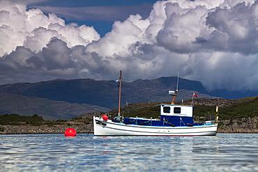 Small boat in the port of Kyleakin on the Isle of Skye, Scotland, United Kingdom, Europe