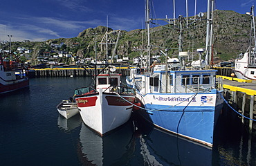 Houses and fishing boats in the harbor of St John´s, Newfoundland
