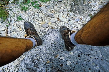 Men\'s legs wearing hiking boots, Europe