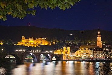 Historic centre of Heidelberg with Old Bridge and Heidelberg Castle at Neckar River at night, Baden-Wuerttemberg, Germany, Europe