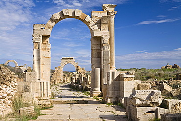 Arch of Trajan on Via Trionfale, Arch of Tiberius in the back, Leptis Magna, Libya, North Africa