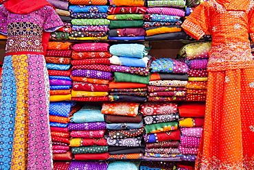 Kurti and saris stacked for sale, Jodhpur, Rajasthan, India, Asia