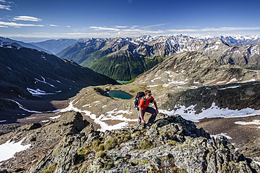 Mountaineer during the ascent of Mt Grawand , Ortler Alps at the back, Val Senales below with the Vernagt Reservoir, Meraner Land area, Merano, Meran region, South Tyrol, Italy, Europe