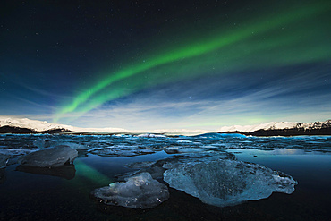 Chunks of ice in the water at the blue hour with polar lights, Jökulsárlón lake, Vik, Iceland, Europe