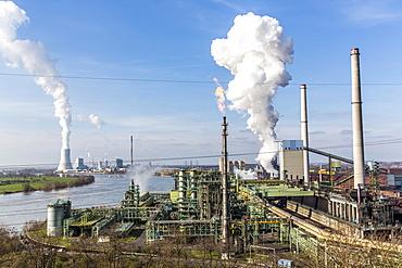 Coking plant, steel plant by the Rhine, furnaces Schwelgern 1 and 2, cooling tower of coal power plant Duisburg Walsum behind, ThyssenKrupp Steel Europe, Hamborn, Duisburg, North Rhine-Westphalia, Germany, Europe