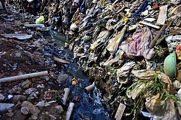 Sewer, contaminated stream in the favela Buraco do Tatu, Sapopemba, Zona Suedeste, São Paulo, Brazil, South America
