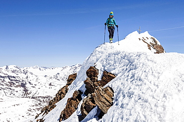 Climber descending from the summit ridge of the Finailspitze peak at Val Senales glacier, snow, Val Senales, Meraner Land, Oetztal Alps, Province of South Tyrol, region of Trentino-Alto Adige, Italy, Europe