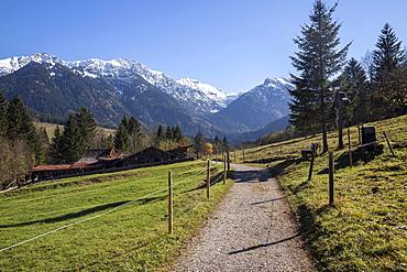 Dirt road and Kutschenmuseum Hinterstein carriage museum, behind the Allgäu Alps, Hinterstein, Allgäu, Bavaria, Germany, Europe