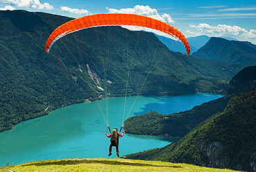 Paraglider starting above Molveno Lake, Trentino Province, Italy, Europe
