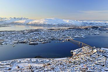 Snowy town with bridge, islands in the North Sea, Tromso, Tromsoysund, Troms, Norway, Europe