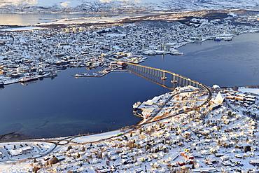 Snowy town with bridge, Tromso, Tromsoysund, Troms, Norway, Europe