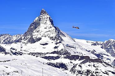 Matterhorn and helicopter from Gornergart, Zermatt, Switzerland, Europe