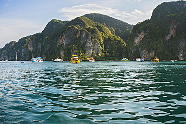 Tourists boats in front of rocks, Ko Phi Phi Island, Phuket, Thailand, Asia