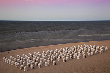 White beach chairs on the beach at twilight, Baltic Seaside Resort Sellin, Rügen, Mecklenburg-Western Pomerania, Germany, Europe