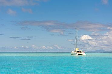Catamaran in turquoise lagoon, Raiatea, South Pacific, French Polynesia, Oceania