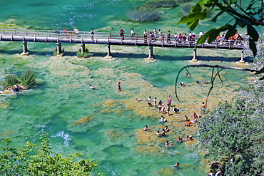 Tourists bathe at the waterfall Smotorcycleinski Buk, National Park Krka, Sibenik-Knin, Dalmatia, Croatia, Europe