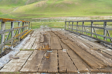 Old wooden bridge over a Mountain river, Naryn gorge, Naryn Region, Kyrgyzstan, Asia