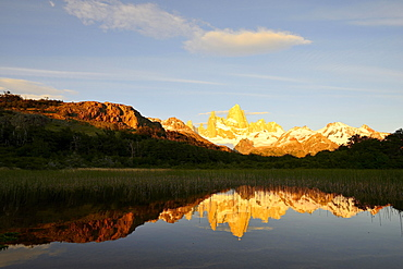 Mountain range with Cerro Fitz Roy at sunrise reflected in Lago de Los Tres, Los Glaciares National Park, El Chaltén, Santa Cruz Province, Patagonia, Argentina, South America