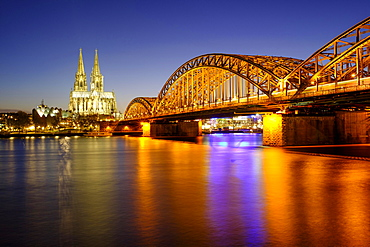 Cologne Cathedral with Hohenzollern Bridge over the Rhine, Dusk, Cologne, North Rhine-Westphalia, Germany, Europe