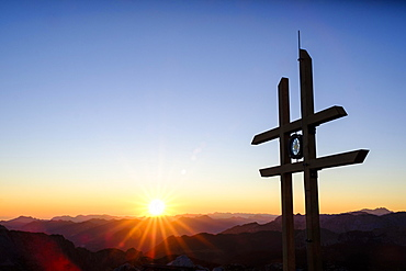 Sunrise at the summit cross Kahlersberg, 2.350m, Berchtesgaden Alps, Germany, behind the northern limestone Alps, Austria, Europe