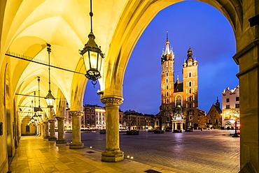 Illuminated market square at dawn, Krakow, Poland, Europe