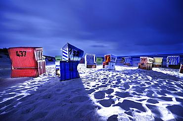 Dramatically illuminated beach chairs at night, Langeoog Beach, East Frisian Islands, Germany, Europe