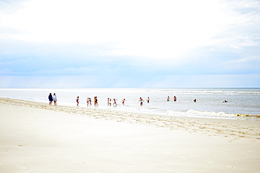 Children play and swim on the beach, Langeoog, East Frisian Islands, Germany, Europe