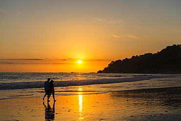 Man and woman strolling on the beach, sunset, Playa Espadilla, Manuel Antonio National Park, Costa Rica, Central America