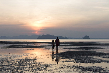 Couple at low tide on the beach at sunset, Tubkaek, Phang Nga Bay, Krabi Province, Thailand, Asia