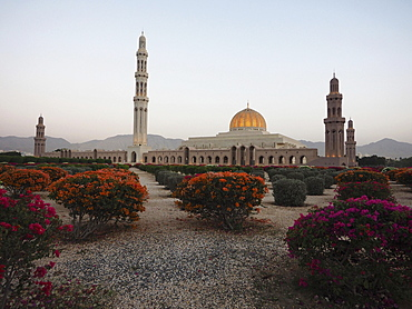 Evening atmosphere, Great Sultan Qabus Mosque, garden with flowering rhododendron, Muscat, Oman, Asia