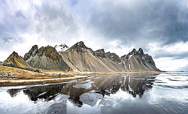 Water reflection, mountains Klifatindur, Eystrahorn and Kambhorn, Stokksnes headland, Klifatindur mountain range, Eastern Region, Iceland, Europe