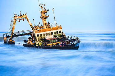 Shipwreck Zeila in the water with swell, Henties Bay, Erongo region, Namibia, Africa