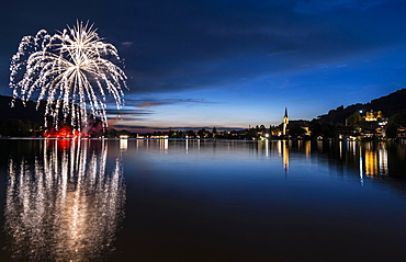 Fireworks, reflection in Lake Schliersee, St. Sixtus Parish Church, Schliersee, Upper Bavaria, Bavaria, Germany, Europe