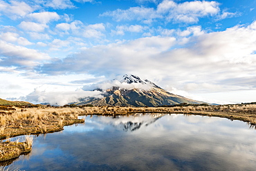 Reflection in Pouakai Tarn, stratovolcano Mount Taranaki or Mount Egmont, Egmont National Park, Taranaki, New Zealand, Oceania