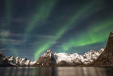Northern Lights or Aurora Borealis over mountains, Hamnoy, Hamnoy, Reine, Moskenesøy, Lofoten, Norway, Europe