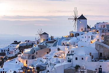 Townscape with windmills, dusk, Oia, Santorini, Cyclades, Greece, Europe