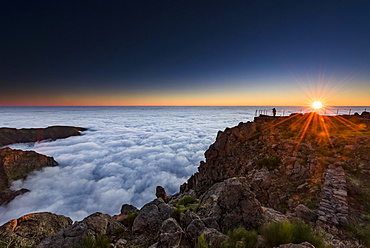 Sunrise over sea of mist, photographer on mountain peak, Pico de Arieiro, Funchal, Madeira