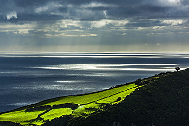 Atmospheric light over the sea, near Cedros, island of Flores, Azores, Portugal, Europe