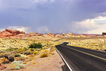 Lonely road through desert, thunderstorm forming, Valley of Fire, Nevada, USA, North America