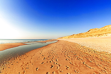 Footprints on the Weststrand beach, red cliff, Kampen, Sylt, North Frisia, Schleswig-Holstein, Germany, Europe