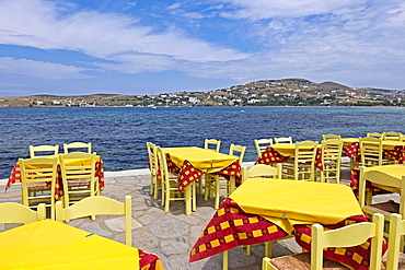 Tables and chairs at a restaurant by the sea, Parikia, Paros Island, Cyclades, Greece, Europe