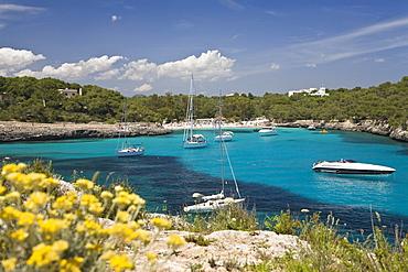 Sailing yachts in the Cala Mondragó bay, beach of Caló d'en Garrot, natural park of Mondragó, Mallorca, Majorca, Balearic Islands, Mediterranean Sea, Spain, Europe