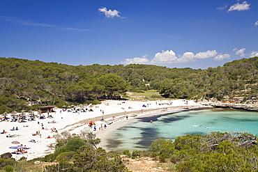 Beach life in the bay of s'Amarador, Cala Mondragó, natural park of Mondragó, Mallorca, Majorca, Balearic Islands, Mediterranean Sea, Spain, Europe