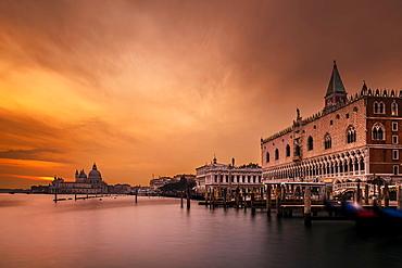 Doge's Palace, St Mark's Square, behind Santa Maria della Salute at sunset, Venice, Veneto, Italy, Europe